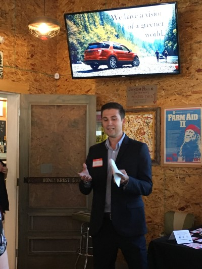 Tyler Hill spoke to guests about the company's commitment to greener cars.
